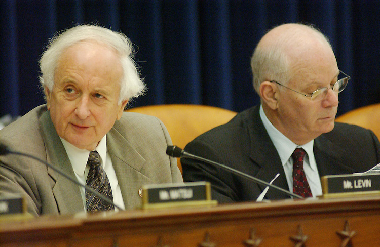 "10/28/03.CORPORATE TAX REVISION--Sander M. Levin, D-Mich., and Benjamin L. Cardin, D-Md., during the House Ways and Means Committee markup of HR 2896, the.""American Jobs Creation Act of 2003."" .From CQToday: The House bill is a compromise package of corporate tax changes designed to eliminate an export subsidy declared illegal by the WTO while providing new tax benefits to domestic manufacturers and U.S.-based multinational corporations..A total of $140 billion in tax cuts are proposed, including some narrowly targeted breaks for such varied industries as fishing-tackle box manufacturers and restaurants..It would be partially offset with $80 billion in revenue increases, including curbs on tax shelters, that were included to hold down the bill's cost..CONGRESSIONAL QUARTERLY PHOTO BY SCOTT J. FERRELL"
