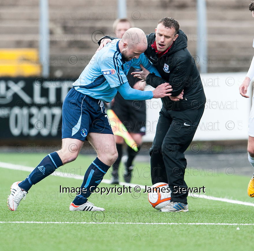 Forfar's Ross Campbell tussles with Ayr Utd Manager Mark Roberts.
