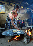 A woman prepares food in Tuixcajchis, a small Mam-speaking Maya village in Comitancillo, Guatemala.