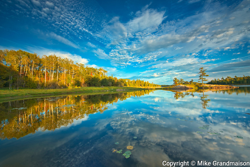 Clouds reflected in Middle Lake <br />