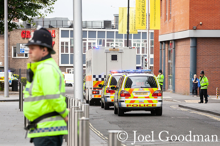 © Joel Goodman - 07973 332324 . 01/06/2012. Manchester , UK. Armed police outside Manchester Crown Court , flanking a prison van believed to be carrying Kiaran Stapleton , the man accused of murdering Indian student Anuj Bidve on Boxing Day 2011 . Photo credit : Joel Goodman
