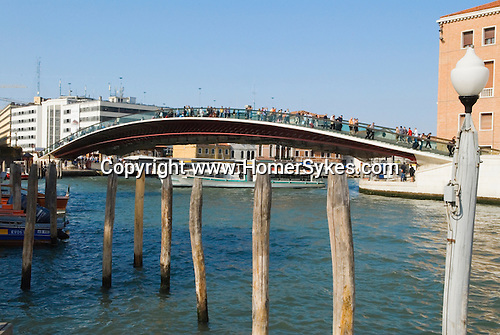 Venice Italy 2009. Tourists walk over new bridge from Piazza Roma Grand Canal