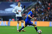 7th January 2018, Wembley Stadium, London, England;  FA Cup football, 3rd round, Tottenham Hotspur versus AFC Wimbledon; Erik Lamela of Tottenham Hotspur passes the ball round Jonathan Meades of AFC Wimbledon