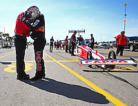 Mar 28, 2014; Las Vegas, NV, USA; NHRA top fuel dragster driver Steve Torrence (right) prays with Racers for Christ champlain Jim Jack prior to climbing into his car during qualifying for the Summitracing.com Nationals at The Strip at Las Vegas Motor Speedway. Mandatory Credit: Mark J. Rebilas-USA TODAY Sports