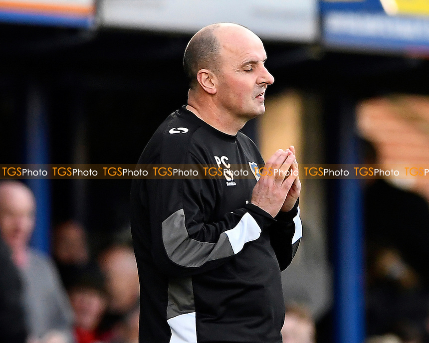 Portsmouth Manager Paul Cook appears to be saying a prayer during Portsmouth vs Crewe Alexandra, Sky Bet EFL League 2 Football at Fratton Park on 4th March 2017