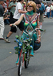 A colorful painted bicycle rider peddles down the street during the 21st Annual Fremont Summer Solstice Parade in Seattle on June 20, 2009. The parade was held Saturday, bringing out painted and naked bicyclists, bands, belly dancers and floats. (Jim Bryant Photo © 2009)