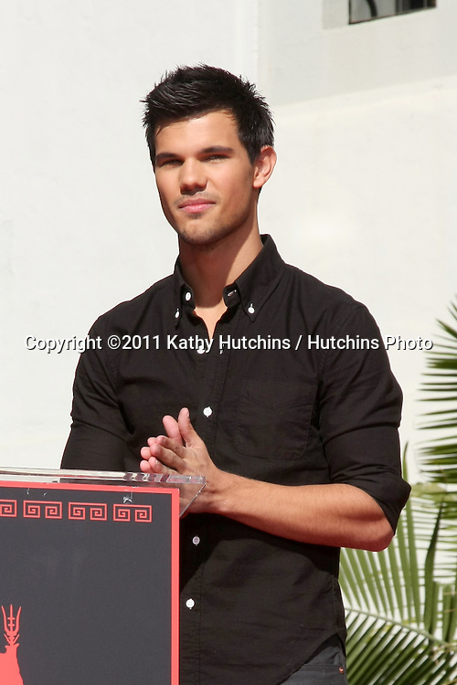 LOS ANGELES - NOV 3:  Taylor Lautner at the Handprint and Footprint Ceremony for the Twilight Saga Actors at Grauman's Chinese Theater on November 3, 2011 in Los Angeles, CA