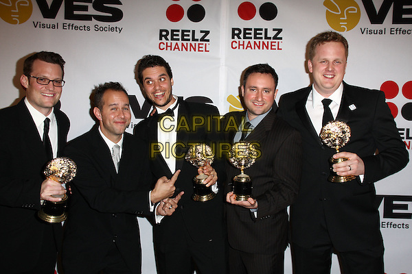 WINNERS - Robert Moggach, Ryan Meredith, Jens Salzala, Michael Pardee.8th Annual VES Awards Press Room held At The Haytt Regency Century Hotel, Century City, California, USA..February 28th, 2010.half length suit black trophy suit .CAP/ADM/KB.©Kevan Brooks/AdMedia/Capital Pictures.