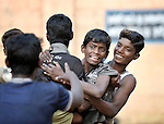 Boys who work as scavengers in the municipal garbage dump in Chennai, India, play in the courtyard of a nearby night shelter where they spend the night. The center is sponsored by the Madras Christian Council of Social Service.