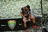 Liam Messam sits on the stage removing tape after the presentation. Grand Final. Crusaders v Chiefs.<br /> Day 2. Brisbane Global Rugby Tens, Suncorp Stadium, Brisbane, Australia. Sunday 12 February 2017. &copy; Copyright photo: Andrew Cornaga / www.photosport.nz