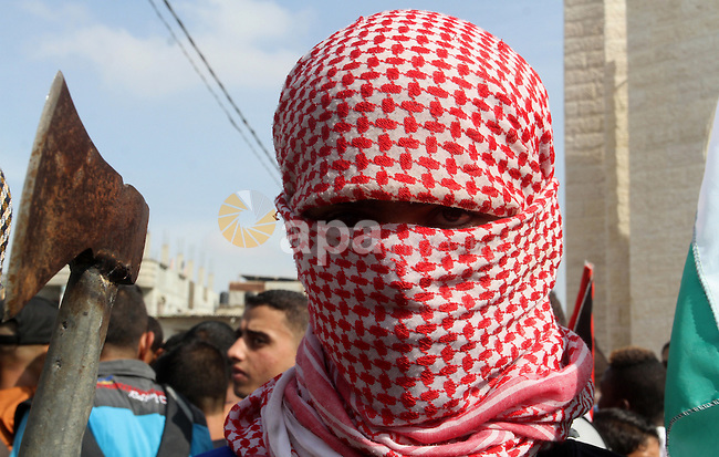 Palestinians take part in an anti-Israel protest in the southern Gaza Strip town of Rafah on October 13, 2015, as a wave of stabbings has hit Israel, Jerusalem and the West Bank along with violent protests in annexed east Jerusalem and the occupied West Bank, leading to warnings that a full-scale Palestinian uprising, or third intifada, could erupt. The unrest has also spread to the Gaza Strip, with clashes along the border in recent days leaving nine Palestinians dead from Israeli fire. Photo by Abed Rahim Khatib
