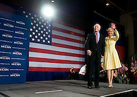 John McCain, U.S. senator from Arizona and 2008 Republican presidential candidate, and his wife Cindy Hensley McCain greet a crowd during a Watch Party in Dallas, Texas, U.S., on Tuesday, March 4, 2008. McCain won the nomination for the Republican party on Tuesday. Photographer: Matt Nager/Bloomberg News