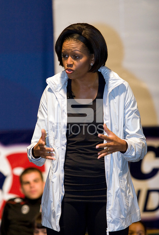 First Lady Michelle Obama talks to an assembled crowd of local children during a US Soccer Foundation clinic held at City Center in Washington, DC.