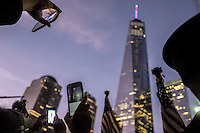NEW YORK, NY - SEPTEMBER 11,2016: People take photographs with their cellphones of the Freedom Tower during the evening of the 15th anniversary of the 9/11 attacks on September 11, 2016 in New York. Photo by (VIEWpress/Maite H. Mateo)