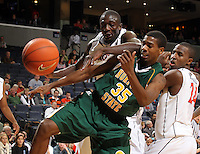 Dec. 20, 2010; Charlottesville, VA, USA; Norfolk State Spartans guard/forward Chris McEachin (35) goes after a loose ball with Virginia Cavaliers center Assane Sene (5) and Virginia Cavaliers guard K.T. Harrell (24) during the game at the John Paul Jones Arena. Mandatory Credit: Andrew Shurtleff