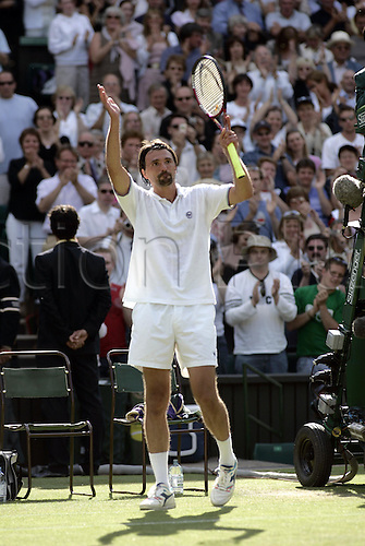 25 June 2004: Croation player GORAN IVANISEVIC applauds the crowd at the end of his third round mens singles match against Hewitt at the All England Lawn Tennis Championships, Wimbledon, London. Ivanisevic lost to Hewitt 2-6, 3-6, 4-6. Photo: Glyn Kirk/Action plus.. .040625