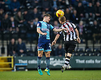 Dominic Gape of Wycombe Wanderers beats Adam Campbell of Notts Co in the air during the Sky Bet League 2 match between Notts County and Wycombe Wanderers at Meadow Lane, Nottingham, England on 10 December 2016. Photo by Andy Rowland.