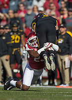 Hawgs Illustrated/BEN GOFF <br /> Dre Greenlaw, Arkansas linebacker, upends Drew Lock, Missouri quarterback, as he throws the ball away in the first quarter Friday, Nov. 24, 2017, at Reynolds Razorback Stadium in Fayetteville.