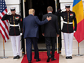 United States President Donald J. Trump and President Klaus Iohannis of Romania walk into the Diplomatic Entrance of the White House in Washington, DC on Tuesday, August 20, 2019.<br /> Credit: Ron Sachs / CNP
