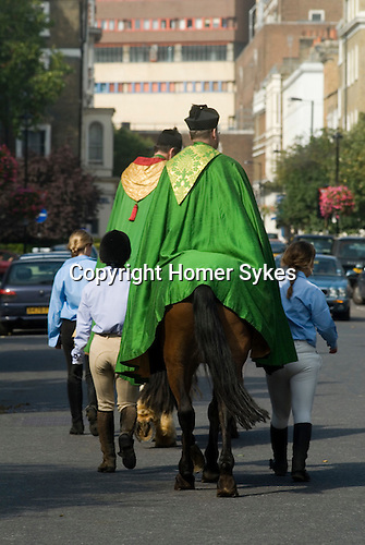 """Horsemans Sunday. Horsemans Sunday, London.  The vicar of St John's Church Hyde Park, appears before his congregation on a horse in the well established St John's tradition known as Horseman's Sunday. The Reverend Stephen Mason traditionally leads a cavalcade of over 100 horses and riders to the church in order to celebrate horse riding in the heart of London. The horses gather on the forecourt of the church for a blessing, followed by a ride-past and a presentation of rosettes. The annual Horseman's Sunday celebrations began nearly 40 years ago in 1968 to highlight the need to maintain stables along the north of Hyde Park; at that time the stables were threatened with closure. What began as a public and political action has become a unique local institution attracting local residents, tourists and horse lovers. As the Revd Mason says, """"This occasion is one of the most colourful events in the Hyde Park calendar. After all, how often do you get to see a cloaked member of the clergy on horseback these days? The Reverend Stephen Mason of St Johns Hyde Park and The Reverend Christopher Burke the Rector of Stepeny at the end of the service with girls from a local stable"""