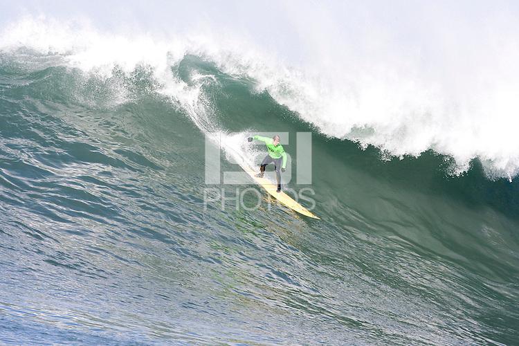 Evan Slater lone riding this wave at  Mavericks Surf Contest 2008.  Half Moon Bay, Ca.  January 12, 2008.