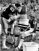 Raiders Gene Upshaw talking to QB Ken Stabler during break..(1971 photo/Ron Riesterer)