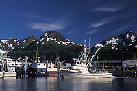 Cordova Harbor is a scenic place, especially when weather allows a view of nearby Chugach Mountains. Cordova, Alaska, USA