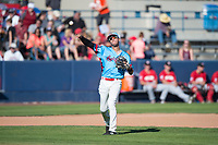 Spokane Indians third baseman Diosbel Arias (21) throws to first base during a Northwest League game against the Vancouver Canadians at Avista Stadium on September 2, 2018 in Spokane, Washington. The Spokane Indians defeated the Vancouver Canadians by a score of 3-1. (Zachary Lucy/Four Seam Images)