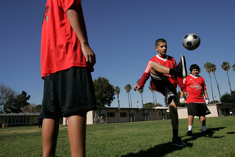 Long Beach California, USA- Soccer players from the Hamilton Middle School Wolverines run through an impromtu parctice in the school feild in Long Beach CA, USA, 12 January 2007. Story on U.S. interest in soccer/football. (Photo: Gerard Burkhart/Getty Images for the Times of London)..GERARD BURKHART PHOTO.818-207-0273.WWW.GBPIX.NET..