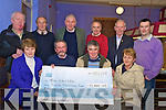 Jim Griffin, Dooks, second from left, pictured as he received a cheque for EUR12,400 from James O'Riordan, Laune Rangers Lotto Committee in the CYMS on Sunday night. Also pictured are Pat Foley, seller, Maria Hayes, Killorglin Credit Union, Edso Crowley, Jim Galvin, Bart Moriarty, Pat O'Riordan, James Murphy and Anthony O'Connor...