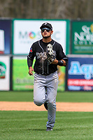 Lansing Lugnuts outfielder Norberto Obeso (9) jogs in from the outfield between innings during a Midwest League game against the Wisconsin Timber Rattlers on May 8, 2018 at Fox Cities Stadium in Appleton, Wisconsin. Lansing defeated Wisconsin 11-4. (Brad Krause/Four Seam Images)