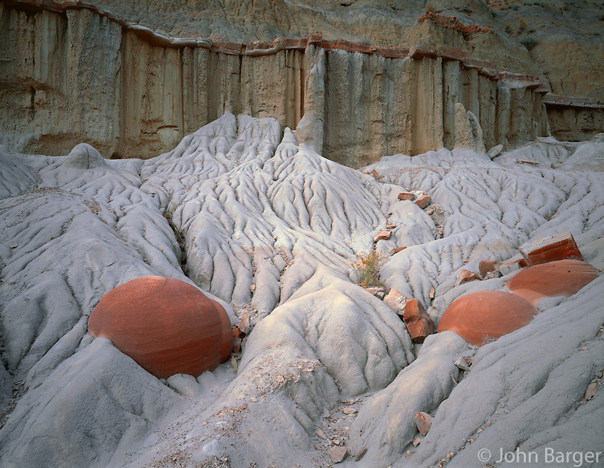 NDTR_110 - USA, North Dakota, Theodore Roosevelt National Park, Erosion resistant concretions are exposed as surrounding softer sediments weather away, Cannonball Concretion Area, North Unit.