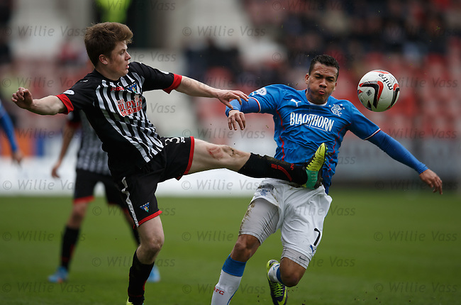 Dunfermline's Alex Whittle with Arnold Peralta of Rangers