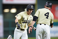 JJ Bleday (51) of the Vanderbilt Commodores high fives head coach Tim Corbin at third base against the Houston Cougars during game nine of the 2018 Shriners Hospitals for Children College Classic at Minute Maid Park on March 3, 2018 in Houston, Texas. The Commodores defeated the Cougars 9-4. (Brian Westerholt/Four Seam Images)