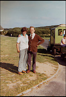 BNPS.co.uk (01202 558833)<br /> Pic: JoyceFaris/BNPS<br /> <br /> ***Please use full byline***<br /> <br /> Joyce and Roger Faris in the 1970s. <br /> <br /> There was outrage today after a family that has run one of Britain's first 'Noddy' land trains for 46 years were served with a notice to quit the service.<br /> <br /> The much-loved novelty train that carries people to a remote beach was started in 1968 by the late Roger Faris, who hand-built the carriages himself.<br /> <br /> Since his death 34 years ago his widow Joyce, 88, has operated the independent service for 364 days a year and runs it more as a hobby than a profitable business.<br /> <br /> The little train has been used by generations of people and become a popular fixture at the Hengistbury Head beauty spot in Dorset.<br /> <br /> Now after five decades of service, town hall officials have told Mrs Faris they will not be renewing their contract with her as they intend to operate their own train service.