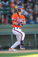 Clemson Tigers right fielder Steven Duggar #9 swings at a pitch during a game against the South Carolina Gamecocks at Fluor Field on March 1, 2014 in Greenville, South Carolina. The Gamecocks defeated the Tigers 10-2. (Tony Farlow/Four Seam Images)