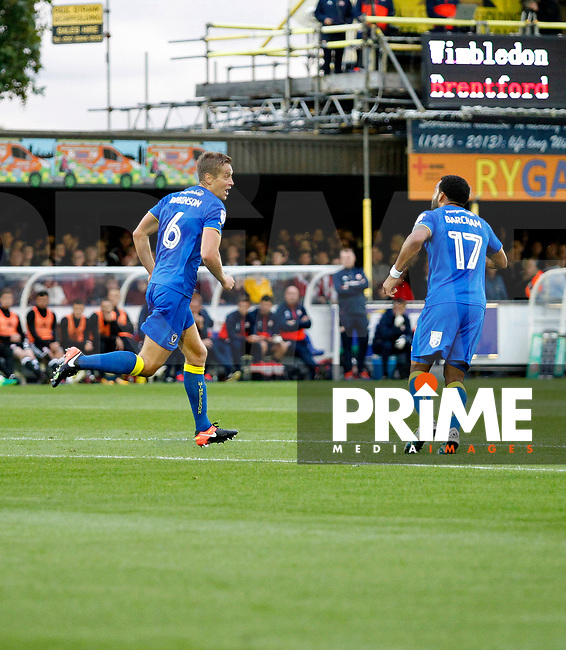 GOAL - AFC Wimbledon's Paul Robinson sees his shot loop in during the Carabao Cup match between AFC Wimbledon and Brentford at the Cherry Red Records Stadium, Kingston, England on 8 August 2017. Photo by Carlton Myrie.