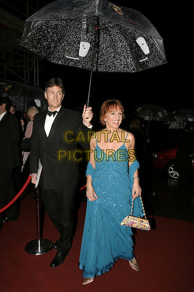 ESTHER RANTZEN.At the After Party for the Pioneer British Academy Television Awards (TV BAFTA's), Grosvenor House Hotel, .London, April 17th 2005..full length umbrella raining blue dress.Ref: AH.www.capitalpictures.com.sales@capitalpictures.com.©Adam Houghton/Capital Pictures.
