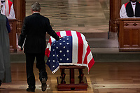 Former President George Bush touches the flag-draped casket of his father, former President George H.W. Bush, as he prepares to speak during his State Funeral at the National Cathedral, Wednesday, Dec. 5, 2018,  in Washington.<br /> Credit: Andrew Harnik / Pool via CNP / MediaPunch