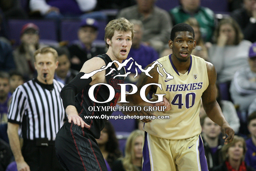February 12, 2014:   Washington's Shawn Kemp Jr against Stanford Grant Verhoeven.  Washington defeated Stanford 64-60 at Alaska Airlines Arena in Seattle, Washington.