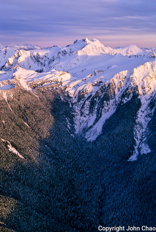 Aerial of the Northeast aspect of Mount Olympus during a winter sunset, Olympic National Park, Washington State