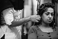 Saira Liaqat, 27 (L) performs hair-straightening to a client at a the Depilex salon where she works as a Beautician in Lahore, Pakistan...Sara had acid thrown at her face 7 years ago by her husband while they where awaiting dowry from her family. Her husband had persistently asked Saira to move in with him, though the families had agreed that Saira should finish school first. Saira has undergone 9 sessions of plastic surgery.