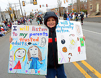 12/1/12 12:38:32 PM - Souderton, PA: .Chris Falbo, 10, of Telford, Pennsylvania holds signs stating he will be good during the holidays as they march on Main Street during the Souderton/Telford Holiday Parade December 1, 2012 in Souderton, Pennsylvania -- (Photo by William Thomas Cain/Cain Images)