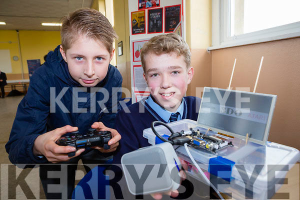Daniel O'Sullivan right with his games console he invented as his class mate Adam Grzesiak plays a game on it at the St Brendan's College Science Fair on Thursday