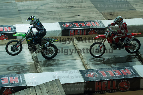 Janos Szucs Kulcsar (L) and Gabor Szatyina (R) from Hungary compete during the Indoor Super Moto-Cross race in Budapest, Hungary on February 4, 2012. ATTILA VOLGYI