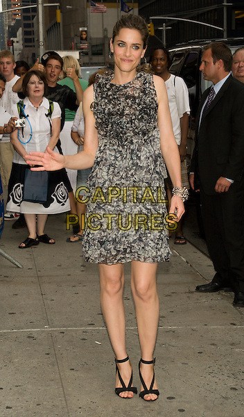 "AMANDA PEET.(promoting ""The X-Files: I Want To Believe"").Appearance on the ""Late Show with David Letterman"" at the Ed Sullivan Theater, New York, NY, USA..July 22nd, 2008.full length black white grey gray ruffled ruffles frills dress sleeveless hand waving .CAP/LNC.©TOM/LNC/Capital Pictures."