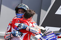 Ducati's Team rider Italian Andrea Dovizioso (C), winner, Movistar Yamaha's Spanish rider Maverick Vinales (L), second, and OCTO Pramac Yakhnich's Italian rider Danilo Petrucci, third, celebrate on the podium after winning the Moto GP Grand Prix at the Mugello race track on June 4, 2017. Ducati's Andrea Dovizioso thrilled the home crowds with a stirring MotoGP victory at Mugello on Sunday that saw him edge championship leader Maverick Vinales. Another Italian, Danilo Petrucci, was third while veteran superstar Valentino Rossi of Yamaha won plaudits for racing in pain from a training accident and finishing fourth having set the early pace.<br /> Photo by Danilo D'Auria.<br /> Danilo D'Auria/UK Sports Pics Ltd/Alterphotos /NortePhoto.com
