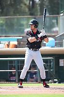 Tirso Ornelas (23) of the Modesto Nuts bats against the Visalia Rawhide at Recreation Ballpark on June 10, 2019 in Visalia, California. (Larry Goren/Four Seam Images)