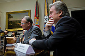 Steve Bannon, chief strategist for U.S. President Donald Trump, and Jonathan Thompson, executive director of the National Sheriffsí Association, listen during a listening session with U.S. President Donald Trump, not pictured, in the Roosevelt Room of the White House in Washington, D.C., U.S., on Tuesday, Feb. 7, 2017. The Trump administration will return to court Tuesday to argue it has broad authority over national security and to demand reinstatement of a travel ban on seven Muslim-majority countries that stranded refugees, triggered protests and handed the young government its first crucial test. <br /> Credit: Andrew Harrer / Pool via CNP