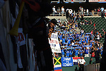 14 November 2004: As Ben Olsen (left foreground) is embraced in celebration by DC fans after the game, Kansas City's fans salute their fallen heros. DC United defeated the Kansas City Wizards 3-2 to win MLS Cup 2004, Major League Soccer's championship game at the Home Depot Center in Carson, CA..